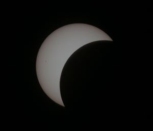 Image of a partial solar eclipse taken through a telescope with a full aperture solar filter fitted, by Geoff Elston