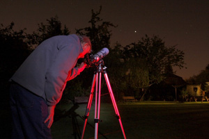 Observer using small telescope.